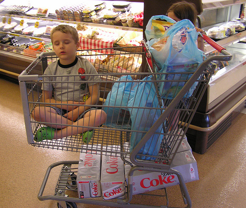 child in shopping cart (image courtesy of Flickr)